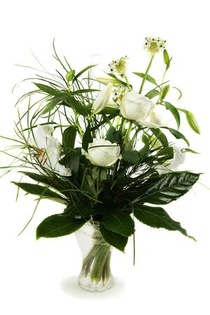Bouquet of white roses and lily in a vase