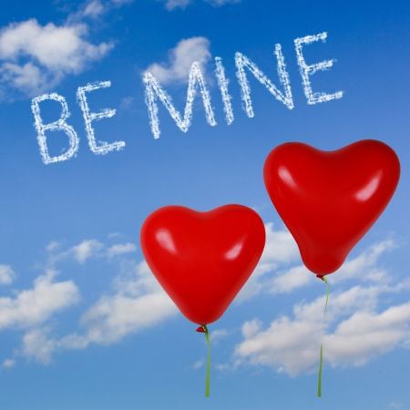 Two heart shaped red balloons in the blue sky with clouds effect text Be mine. Stock Photo - 17254754