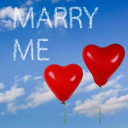 Two red heart shaped balloons with clouds effect words Marry me photo