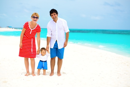 Happy family with baby having tropical vacation  photo