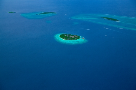 Groups of atolls in the ocean in Maldives photo