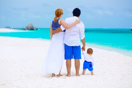 Family of three having tropical vacation at Maldives photo
