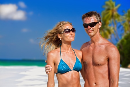 honeymooners: Beautiful young couple on the tropical beach  Stock Photo