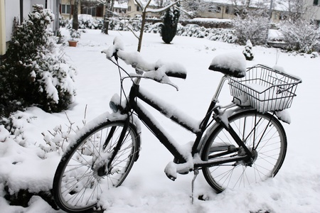 After snowfall - Bike covered with snow photo