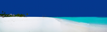 Panorama of beautiful beach on Maldives with clear blue sky, white sand and turquoise water photo