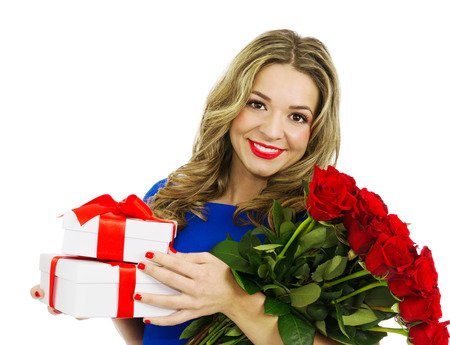 Beautiful blond woman smiling and holding bouquet of red roses and gift boxes, valentines day. Full body portrait, isolated, over white background with copy space. photo