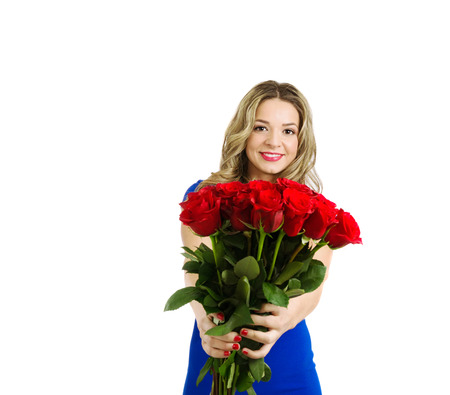 Beautiful blond woman smiling and holding bouquet of red roses, valentines day. Half  body portrait, isolated, over white background with copy space. photo