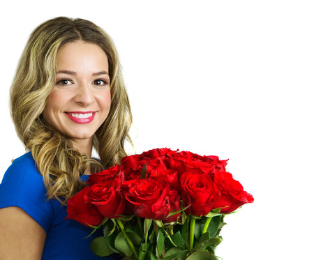 Beautiful blond woman with hairstyle and make up holding bouquet of red roses, valentines day. Studio shot, isolated, over white background with copy space, half body portrait photo