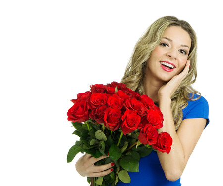 Beautiful blond woman with hairstyle and make up holding bouquet of red roses, valentines day. Studio shot, isolated, over white background with copy space Stock Photo