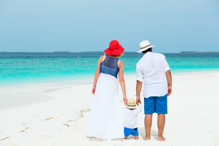Family of three with baby having tropical vacation on Maldives photo