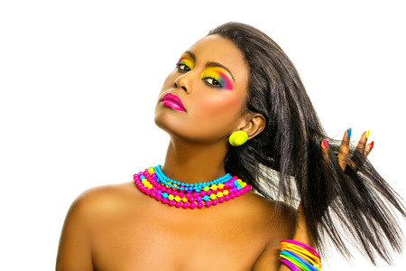 salon background: Beautiful African Model with dark skin, creative colorful rainbow make up and straight shiny hairstyle. Stock Photo