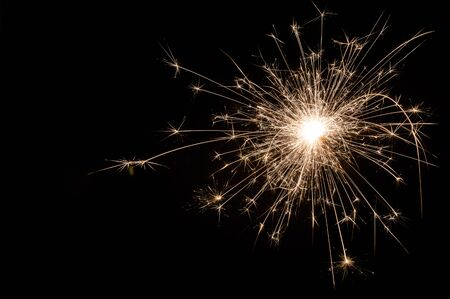 Small new year sparkler on black background. 写真素材