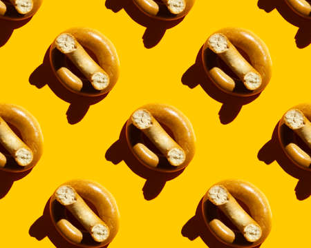 bagel pattern on yellow background. High quality photo
