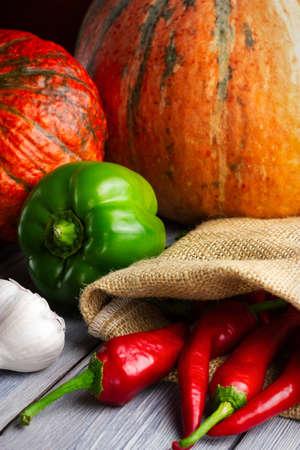 Vegetables, autumn harvest. Pumpkin, garlic, pepper.