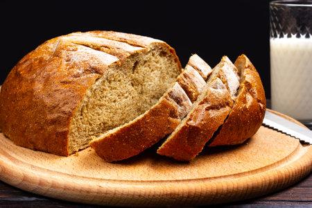 Sliced rye bread on a cutting board. Rustic style.