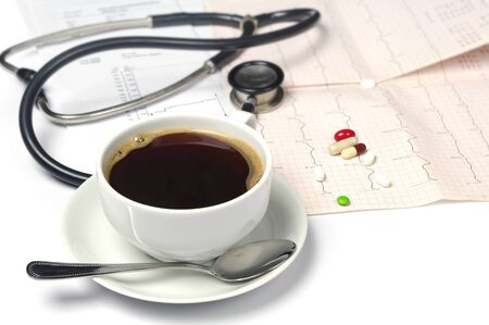 of coffee, electrocardiogram and phonendoscope