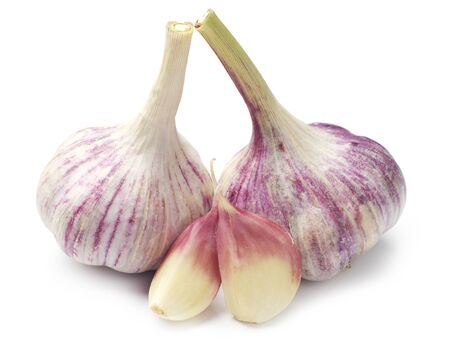 Two full garlic and cloves on white