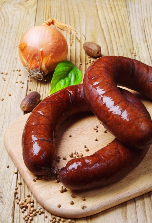 Homemade smoked sausage and onion on a cutting board Stok Fotoğraf