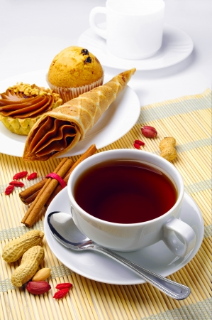 Cup of coffee and cakes on a plate