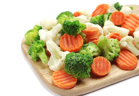 Different frozen vegetables on a cutting board