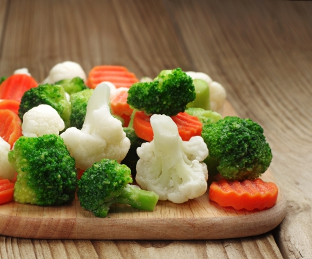 Different vegetables frozen on a cutting board
