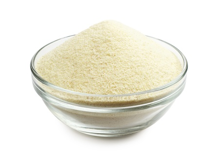 semolina: Semolina in a glass bowl on a white background