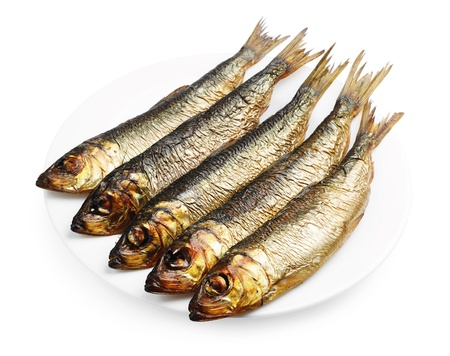 Smoked herring in a plate on white