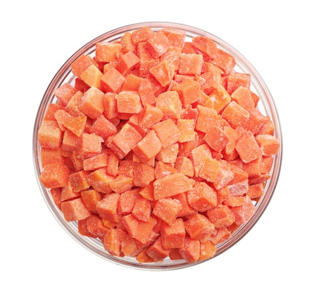 Frozen carrots in a glass bowl isolated on white. Top view