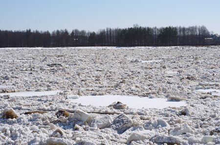 Landscape with drifting ice on the river photo