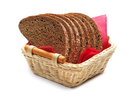 Bread in a basket on white photo