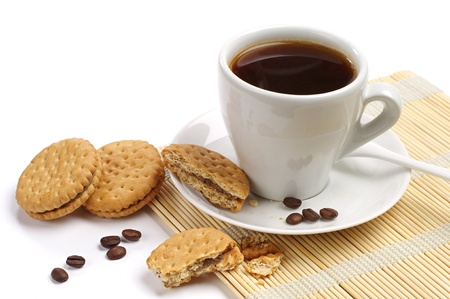 Coffee and cookies on white background