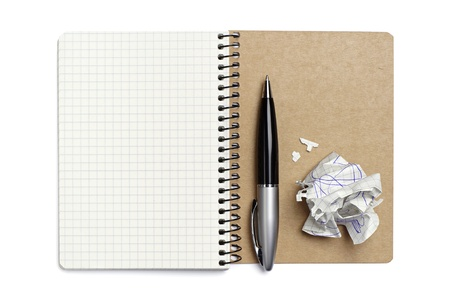 Opened notepad, pen and crumpled paper on white background photo