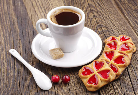 Cup of coffee and cookies with jam and cranberry photo