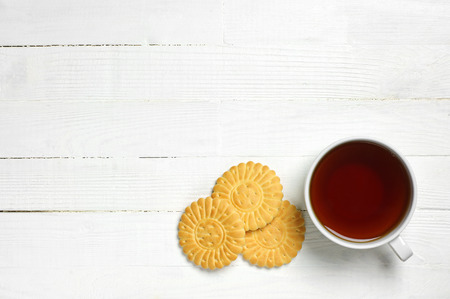 Background with cup of tea and cookies top view photo
