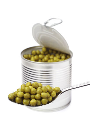 canned peas: Canned peas in spoon and metal jar on white background