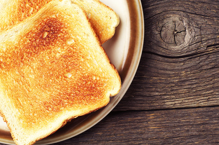 Two toast bread on wooden table closeup Stok Fotoğraf