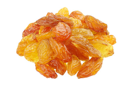 Yellow raisins isolated on white background closeup photo