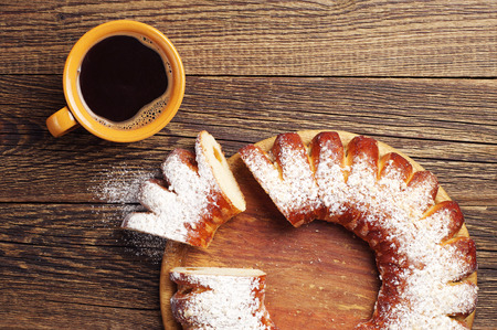 wooden table top view: Sweet pie and cup of hot coffee on wooden table  Top view