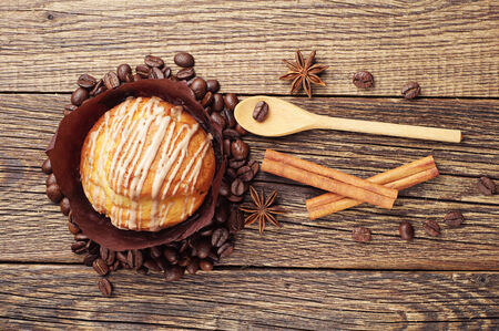 wooden table top view: Delicious muffin on vintage wooden table. Top view Stock Photo