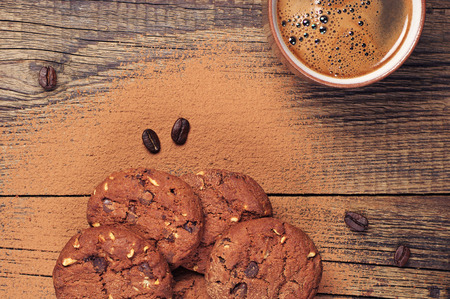 Cup of hot coffee and chocolate cookies with nuts on old wooden table. Top view Reklamní fotografie - 32645209