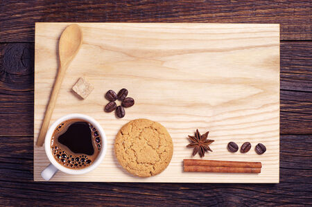 oatmeal cookie: Composition of oatmeal cookie, cup of coffee, cinnamon and anise on a wooden background, top view