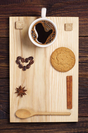 oatmeal cookie: Coffee, beans in shape on hearts and oatmeal cookie on wooden background, top view