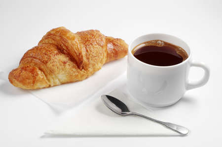 Croissant and cup of hot coffee for breakfast on white background Stock Photo