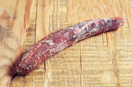 spoilt: Rotten carrot on old wooden background