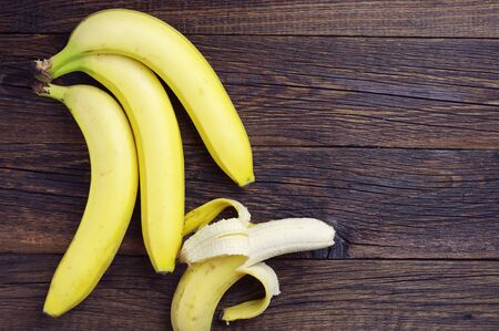 wooden table top view: Bananas on a dark wooden table, top view Stock Photo