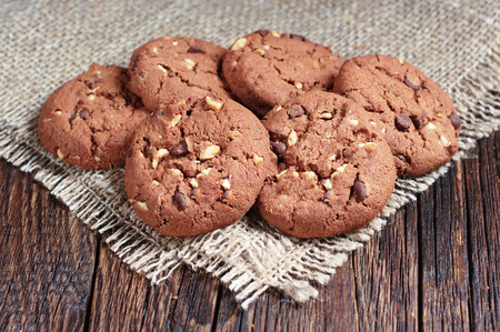 covert: Chocolate chip cookies on wooden table covert burlap