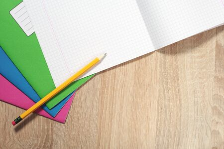 writing materials: School notebooks and pencil on a desk, top view Stock Photo