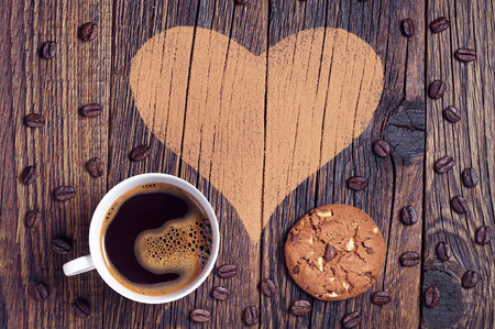 valentine day cup of coffee: Cup of coffee, chocolate chips cookies on background with heart Stock Photo