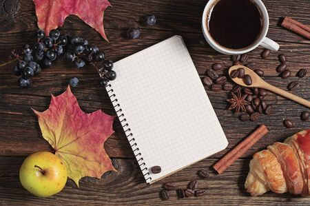 wooden table top view: Composition with notepad, coffee and different fruits on dark wooden table, top view