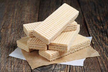 wafers: Delicious wafers on a dark wooden table